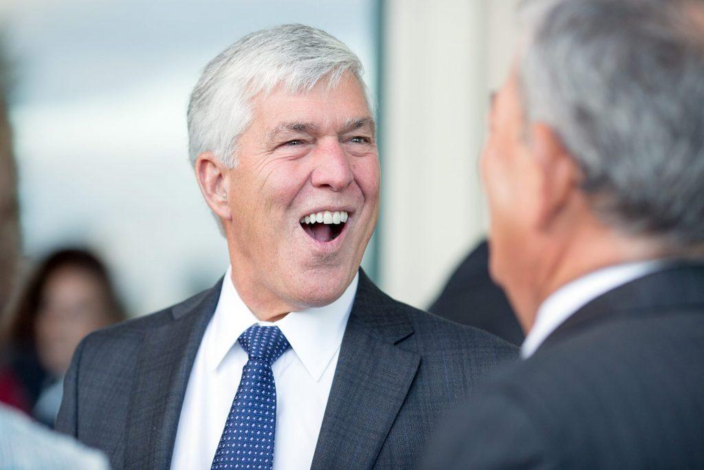 man laughs atreception