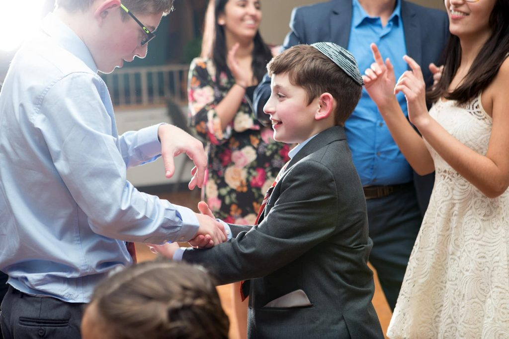 the bar mitzvah boy and his brother dance
