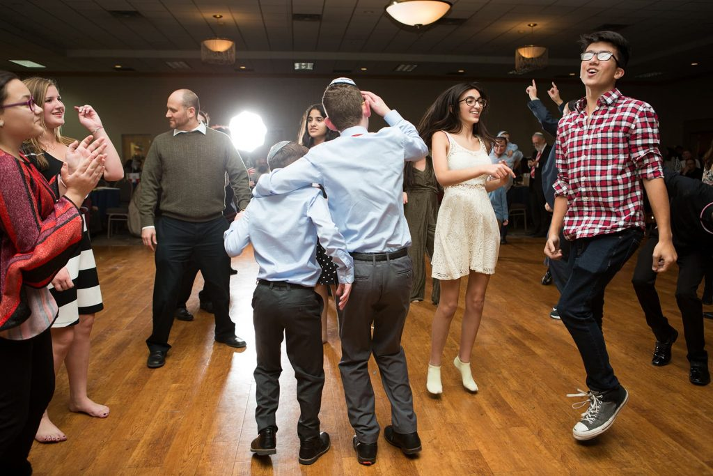 a newly bar mitzvah boy dances with his older brother