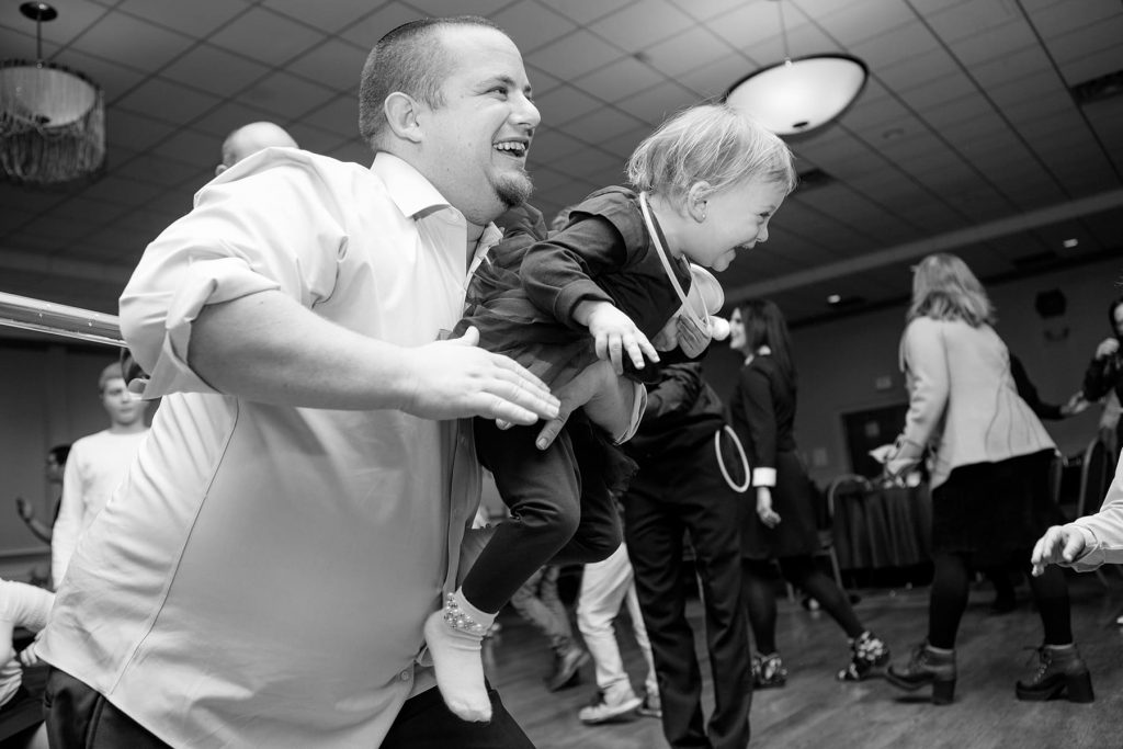 father and daughter laughing after the limbo