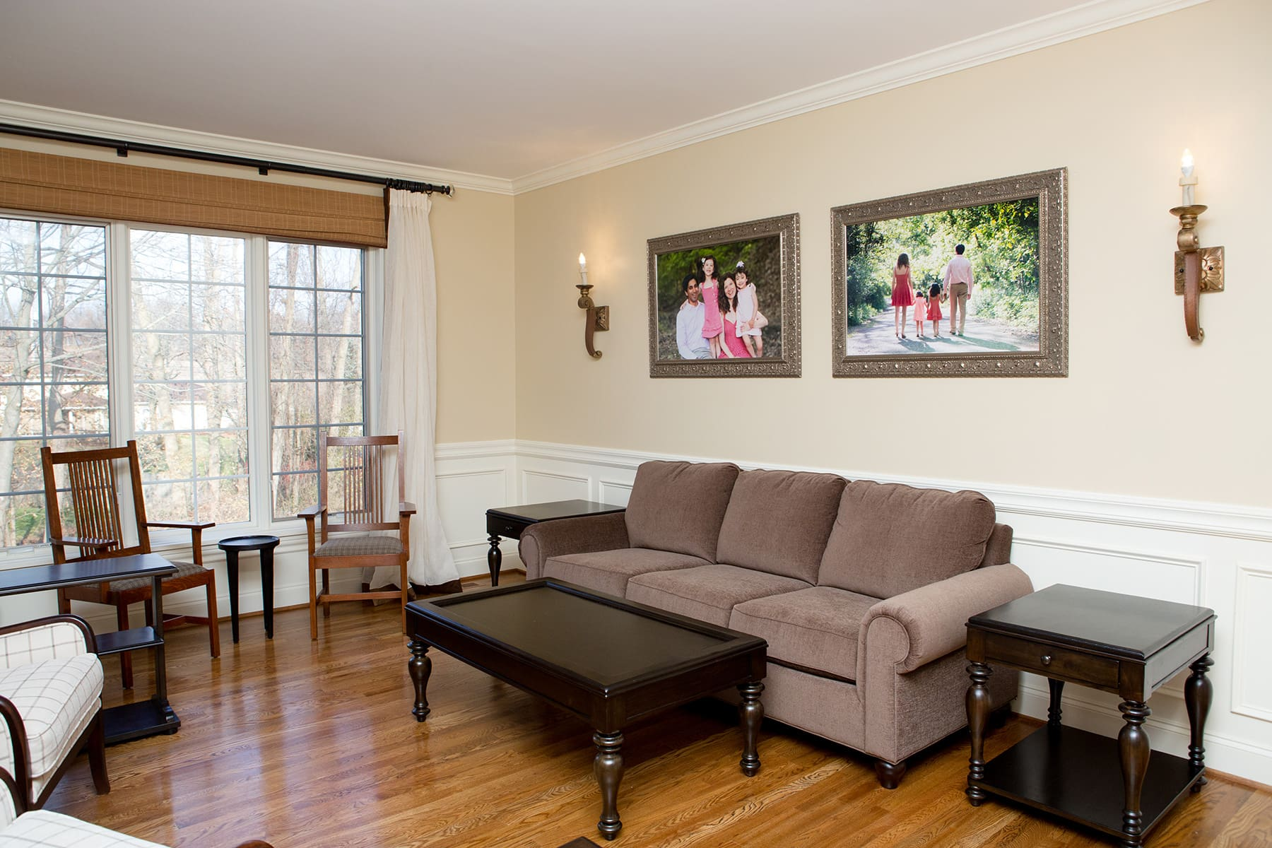 beautiful family portraits hanging in a living room