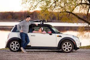 advertisement for a mini cooper car with husband and wife