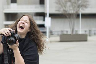 headshot of photographer laughing