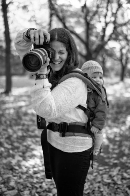 photographer taking a picture while babywearing